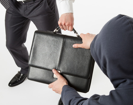swindler: Unknown man take away a businessmans briefcase, white background