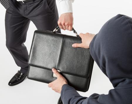 strife: Unknown man take away a businessmans briefcase, white background