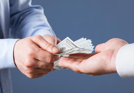 paying money: Businessman paying money