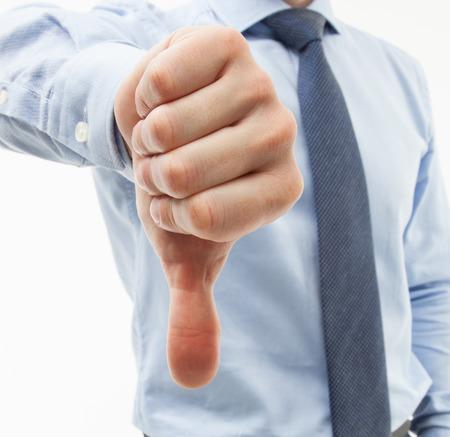 censure: Unrecognizable businessman showing thumb down, white background