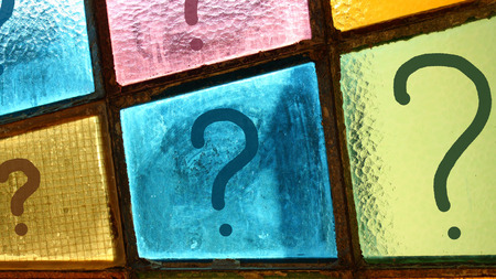 interrogation: Question marks growing from small to big size; interrogation marks painted on stained-glass window Stock Photo