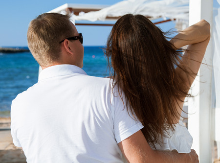 gentle dream vacation: Happy young couple looking on the sea