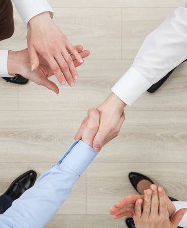 eyewitness: Businessmen shake hands, view from above Stock Photo