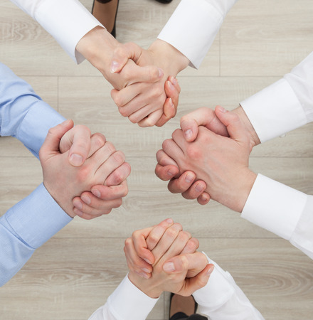 strife: Business people  demonstrating a gesture of a strife or solidarity, view from above Stock Photo