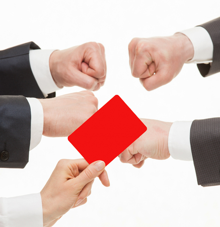 Two businessmen competing, judge showing a red card, white background Stock Photo
