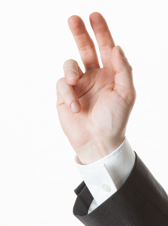 lack of confidence: Businessmans hand showing valedictory gesture, white background Stock Photo