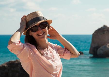 tou: Portrait of a beautiful young woman on the seascape background (Petra Tou Romiou, Cyprus)