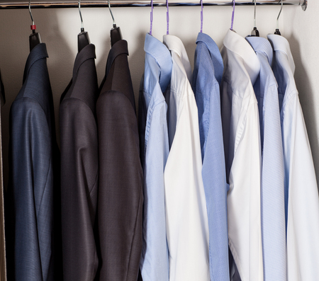 strict: Official strict male clothes in a built-in closet