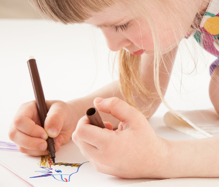beautiful pictures: Little girl drawing  - closeup shot