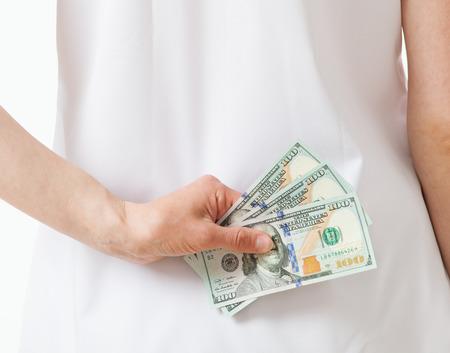 doctor money: Doctor hiding money, white background