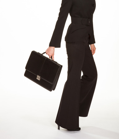 Young woman in a business suit with briefcase, white background