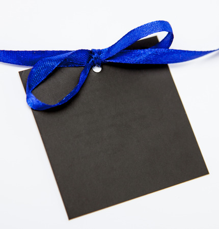 append: Empty black card with bow on white background Stock Photo