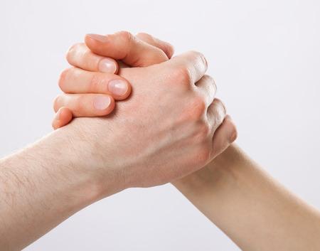 joint effort: Handshake on grey background Stock Photo