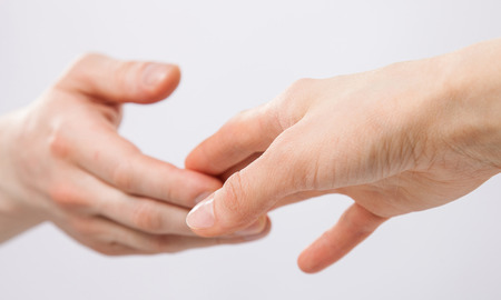 gentle: Gentle touch of man and woman hands Stock Photo