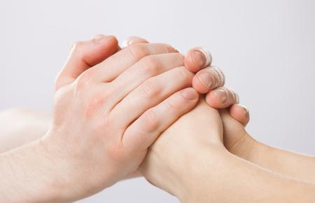 womans hands: Mans hands gently holding womans hands - closeup shot Stock Photo