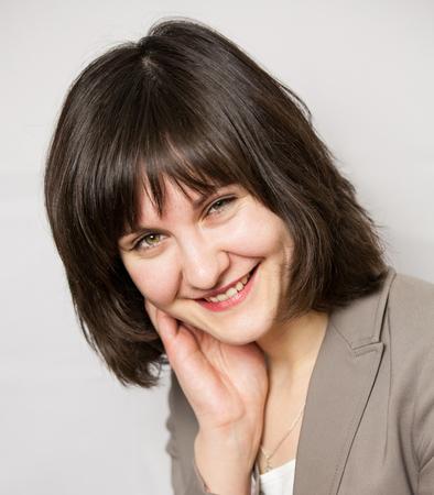neutral: Portrait of a smiling businesswoman, neutral background
