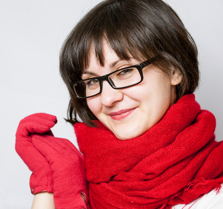 neutral background: Smiling girl in red gloves, neutral background