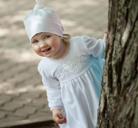 delightful: Delightful little girl playing in summer park Stock Photo