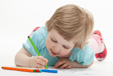 Child drawing a picture with colorful felt-tip pens; white background Stock Photo