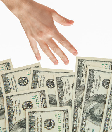 reaching out: Human hand reaching out for money, isolated on white Stock Photo