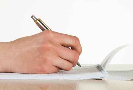 write a letter: Female hand writing down notes Stock Photo