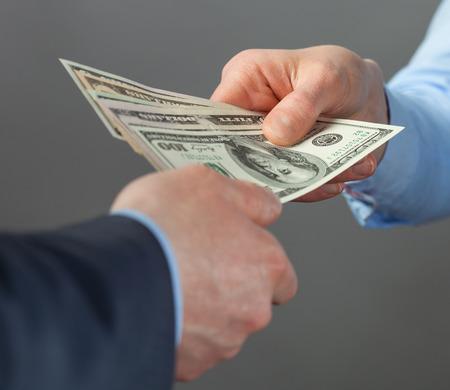 financial official: Human hands exchanging money - closeup shot