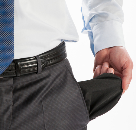 empty: Businessman showing his empty pocket - closeup shot