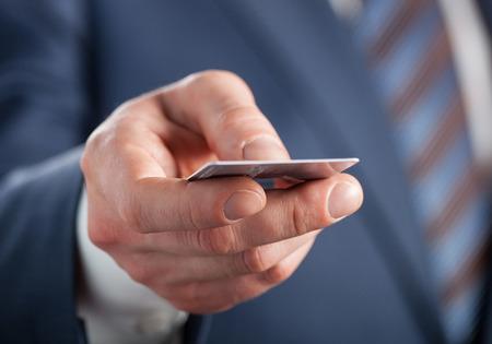 credit crisis: Businessman holding credit card - closeup shot