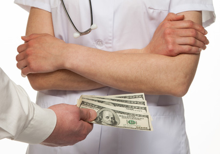 Patient paying money for medical service, white background