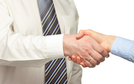 business hand shake: Positive businessman shakes hand of business partner