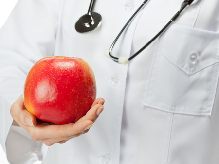 dietology: Doctor proposing apple illustrating healthy eating (or diet)