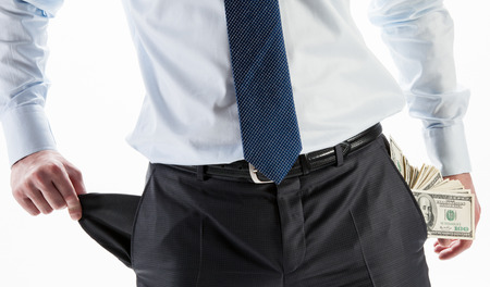 empty pocket: Businessman with a pocket full of money and an empty pocket Stock Photo