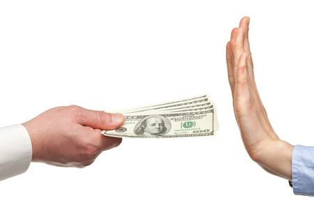 rejecting: Human hands rejecting an offer of money on white background