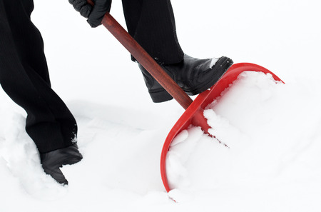 removing: Removing snow with a shovel after snowfall
