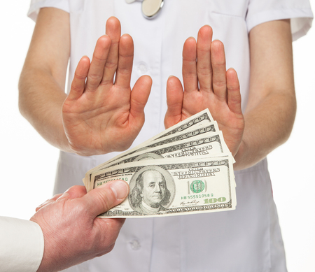 doctor giving dollars: Doctor decidedly refuses to take money from patient, white background