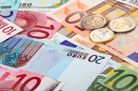 subsidy: Different euro banknotes and coins Stock Photo