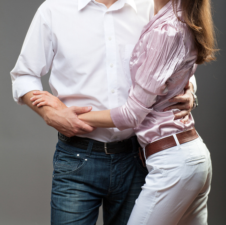 neutral background: Portrait of smiling young couple on neutral background