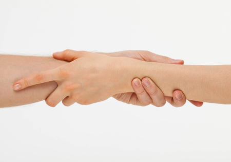 gently: Mans hand gently holding womans hand - closeup shot Stock Photo