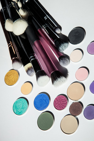multiplicity: Cosmetic brushes and shadows, closeup shot