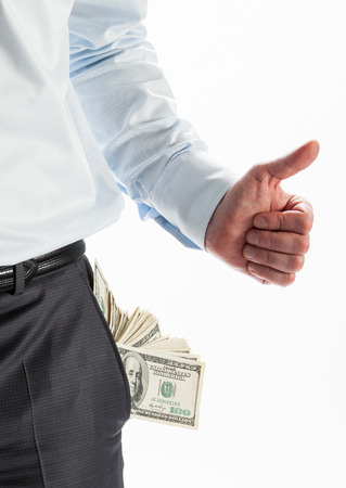 empty pocket: Businessman with a pocket full of money and an empty pocket showing thumbs up and down
