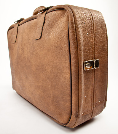 neutral: The leather suitcase; neutral background