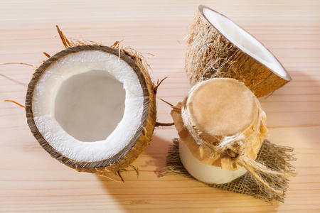 haircare: Fresh coconut and coconut butter on wooden table - natural skincare and haircare composition