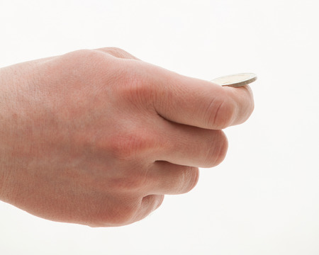 Male hand holding a coin, white background