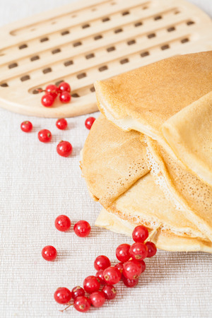 rubicund: Red currant and pancakes on  linen background