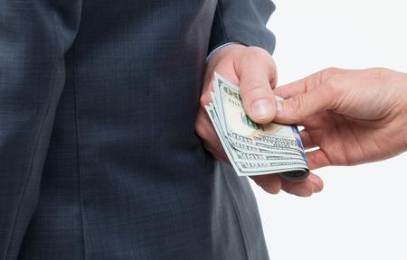 venal: Female hand giving a bribe to businessman - closeup shot