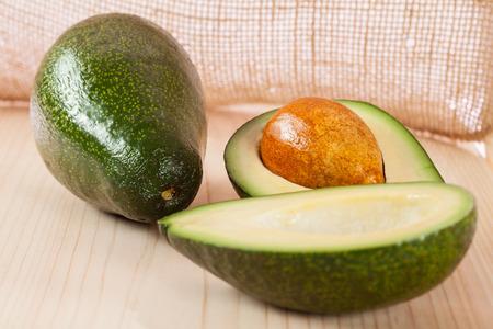 appetizing: Appetizing avocado on wooden table against hessian background