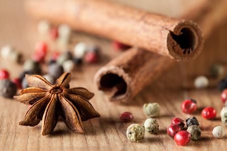 anisetree: Pepper mix, cinnamon,  truestar on wooden  background - macro shot Stock Photo