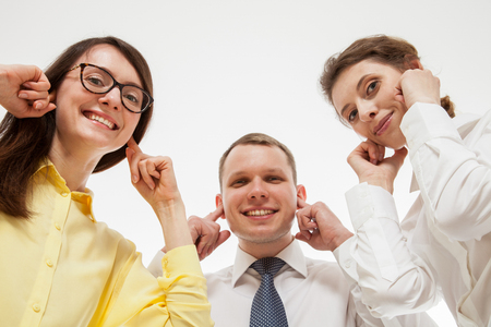 disinclination: Business people refusing to listen somebody, bottom view