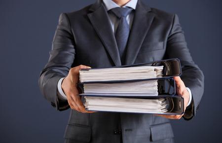 Businessman giving folders to you, closeup shot
