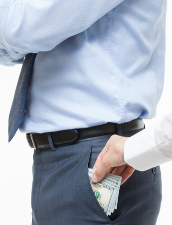 corruptible: Female hand giving a bribe to businessman - closeup shot